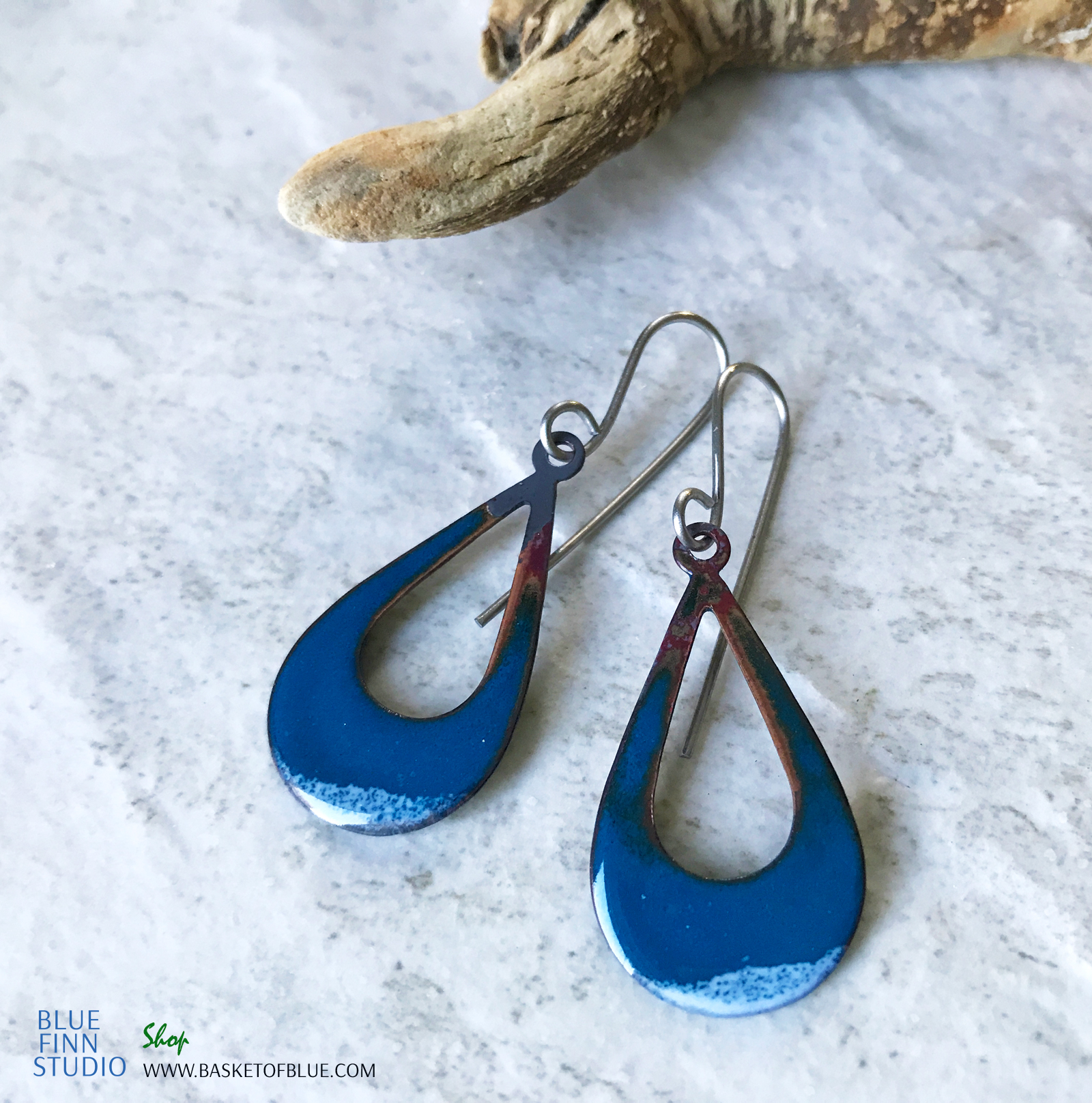 enameled blue open teardrop earring